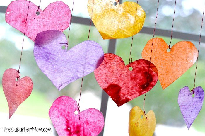 Make these easy Valentine's Day Sun Catchers with broken crayons. Your kids will love this easy Valentine's Day kids craft. Plus it is a pretty decoration.