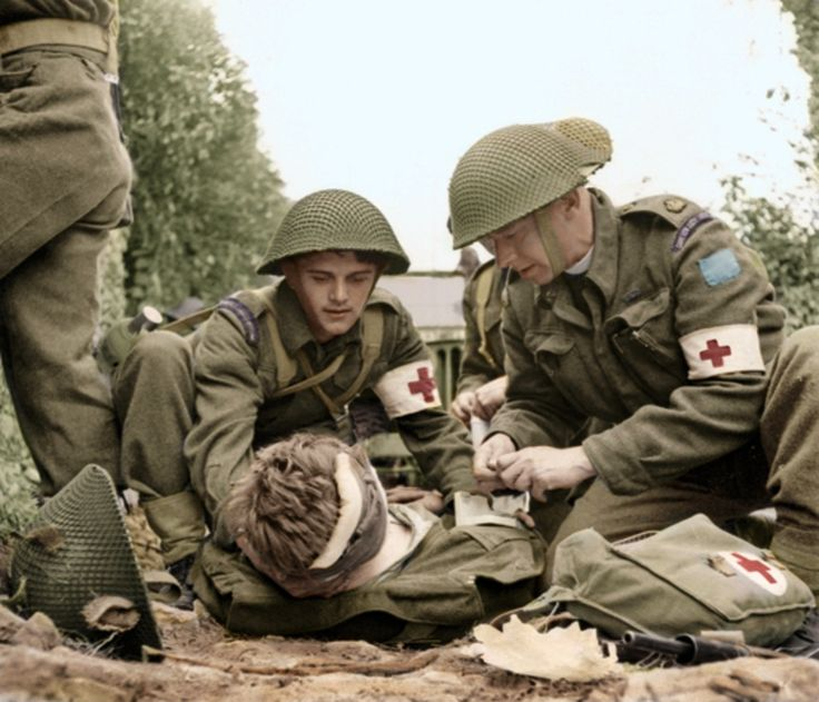 Canadian Medics aid wounded comrade in Normandy 1944