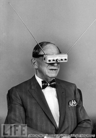 Hugo Gernsback demonstrating his invention, Television Goggles, in 1963.