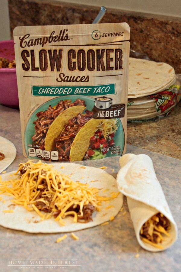 This Slow Cooker Taquitos recipe uses beef, chicken or pork slow-cooked in Campbell's® Shredded Beef Taco Slow Cooker Sauce to make crunchy taquitos that are perfect for an easy weeknight dinner or a party appetizer. #CampbellsSauces