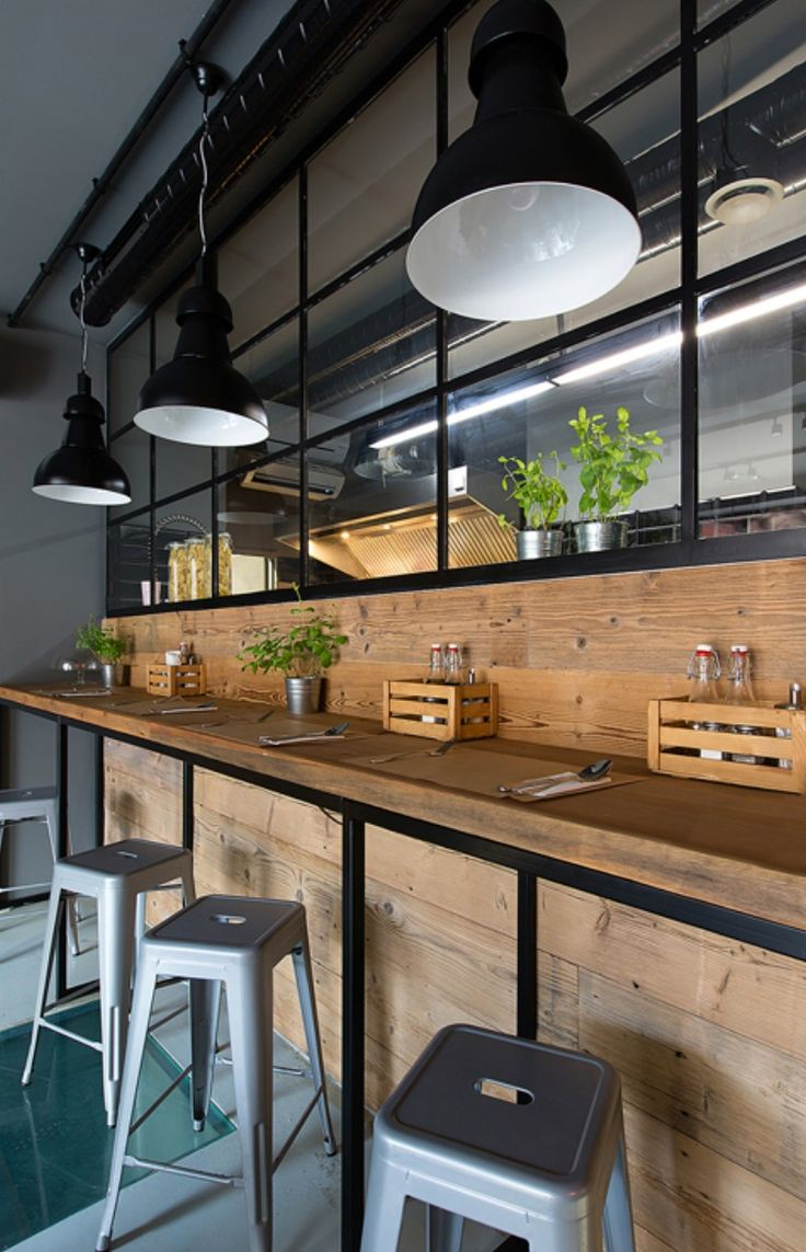 Superpozycja Architekci designed cosy little Bistro 11 on what used to be the site of a hostel for the homeless in central Krakow. The bistro's atmosphere is a combination of New York loft and rustic wood.