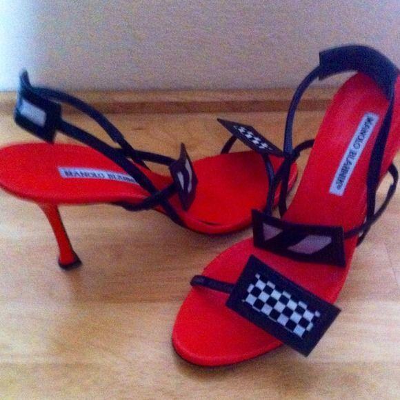 Manolo Blahnik Red Black and White Sandal Beautiful Strappy Red/black and white Manolo Blahnik sandal. Size 38 1/2 (8.5)...4 inch heel Manolo Blahnik Shoes