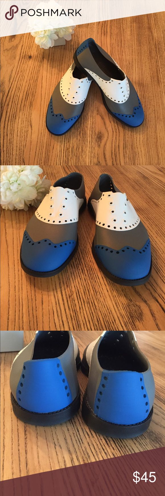 Unisex Biion golf shoes men's 4/woman's 6 Unisex Biion golf shoes are lightweight and breathable. Designed to look like wing tip shoes. Grips on soles for traction in wet grass. Pre owned, worn twice, excellent condition. Men's size 4 Woman's 6 Biion Shoes Athletic Shoes