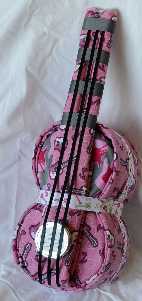 Rock Star Cloth Diaper Cake: We love the fun cloth diapers that are part of this rock star guitar diaper cake ($60).