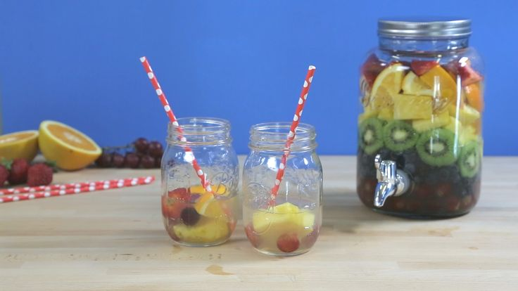 How to Make Rainbow Sangria: Get ready for your next party with this fun rainbow sangria! All you need is: grapes, blueberries, kiwi, pineapple, oranges, strawberries, white wine, Triple Sec, and lemon juice