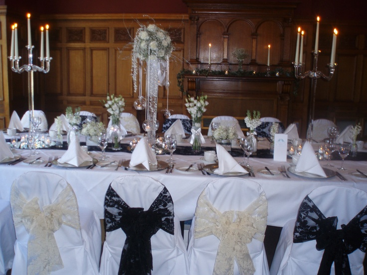 Black and champagne flocked organza sashes on white chair covers at the Crown Hotel Harrogate