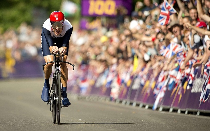 Britain's gold medalist Bradley Wiggins approaches the finish line as he competes in the London 2012 Olympic Games men's individual time trial road cycling