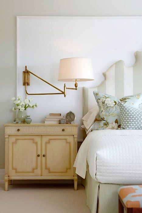 Hot house + stripes + feminine details.  Love the bedside chest and wall sconce