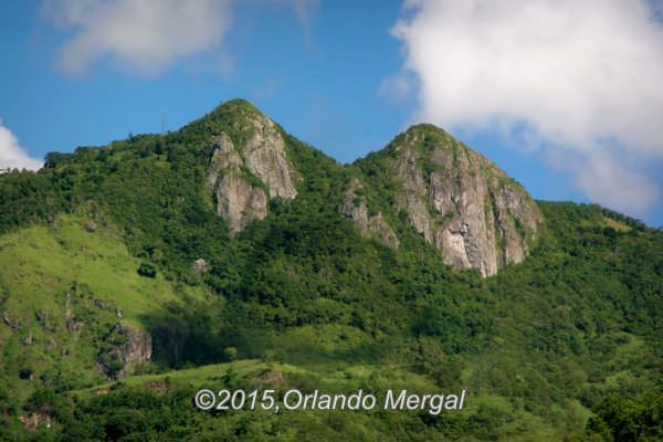 """Las Tetas De Cayey"" are a couple of granite mountains in Puerto Rico that are about halfway between San Juan and Ponce. According to many experts ""Las Tetas De Cayey"" aren't actually in Cayey. One of them is in the town of Coamo and the other is in Salinas. The word ""tetas"" is a colloquial term for breasts, so I guess you could say that ""Las Tetas De Caye"" are the most photographed breasts in Puerto Rico."