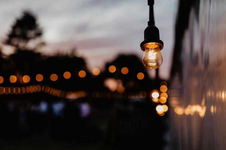 Love a bit of festoon lighting on a warm summer evening. Photo by Benjamin Stuart Photography #weddingphotography #festoon #eveninglight #sunset #weddingday #bokeh