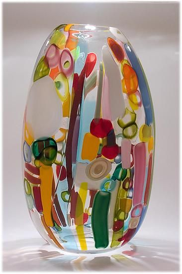 """Tapestry Flat 2"" art glass vessel by Bengt Hokanson and Trefny Dix. Blown glass with multi-coloured transparent and opaque murrinis and cane in many shades of red, blue, green, white, and yellow"
