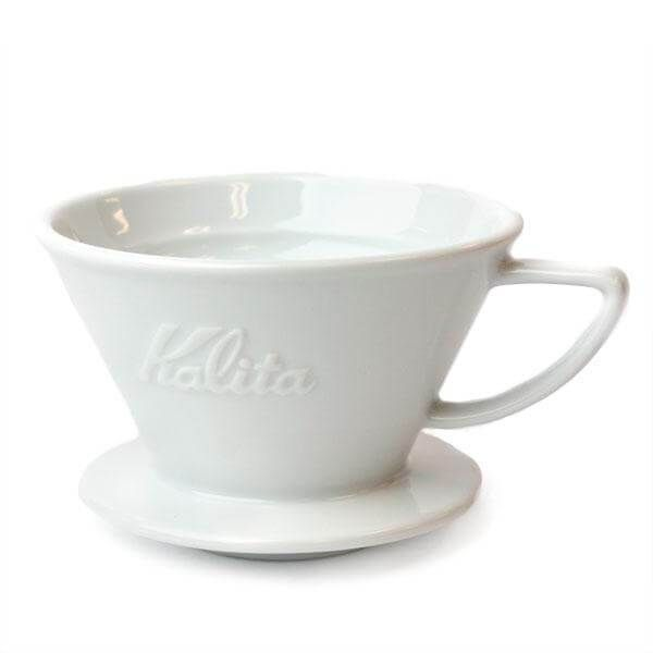 """The Wave Series from Kalita is the premier coffee dripper available on the market. The flat-bottom coffee bed geometry, patented """"Wave"""" filter, and three-hole design work together to provide an even extraction that makes brewing a perfect cup accessible and easy.  Brews 2-4 Cups"""