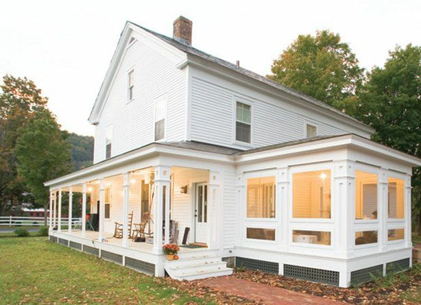 Beautiful farmhouse with four season room, & wrap around porch