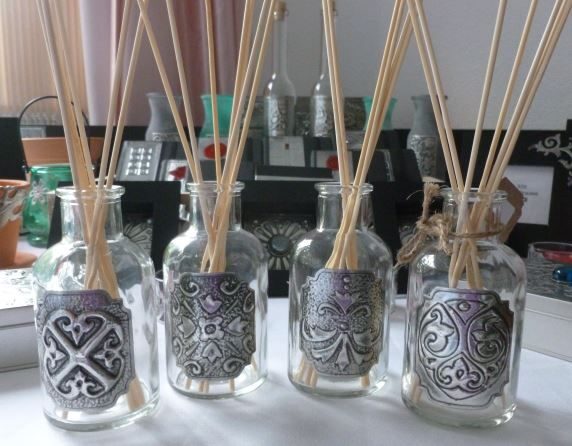 Hand blown glass bottles - sold as essential oil diffusers. Made by Caroline @ Pewter Concepts.