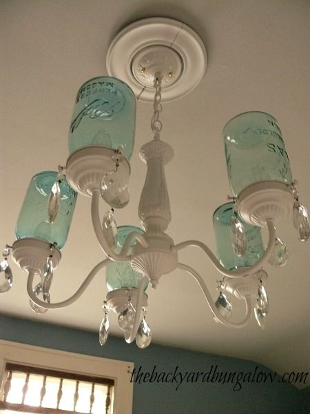 how pretty is this? spray painted light fixture and ball jars added.  Guest bedroom chandelier thebackyardbungalow.com