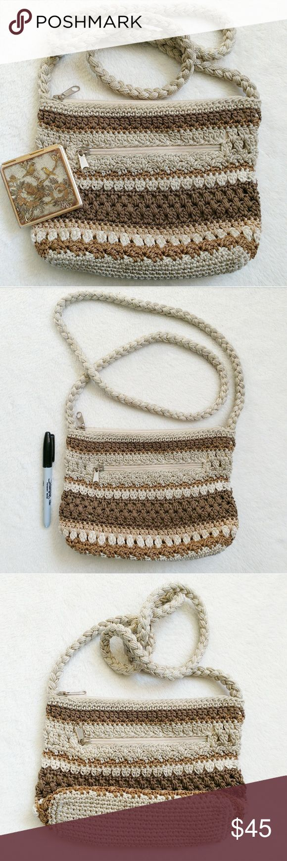 Woven Macrame Tan Brown Neutral Purse Shoulder Bag Neutral toned macrame bag by Lina  Has knotted macrame rope in the colors tan, brown and dark creme   Has a knotted rope strap  Strap is long and could be worn as a shoulder bag or as crossbody   Has a small zipper pocket on the outside and in the inside   Outside is in good condition, with minor wearing on the zipper pulls, but there are several marks on the inside, shown   Sharpie is to show scale   Keywords: vintage style, retro inspired…