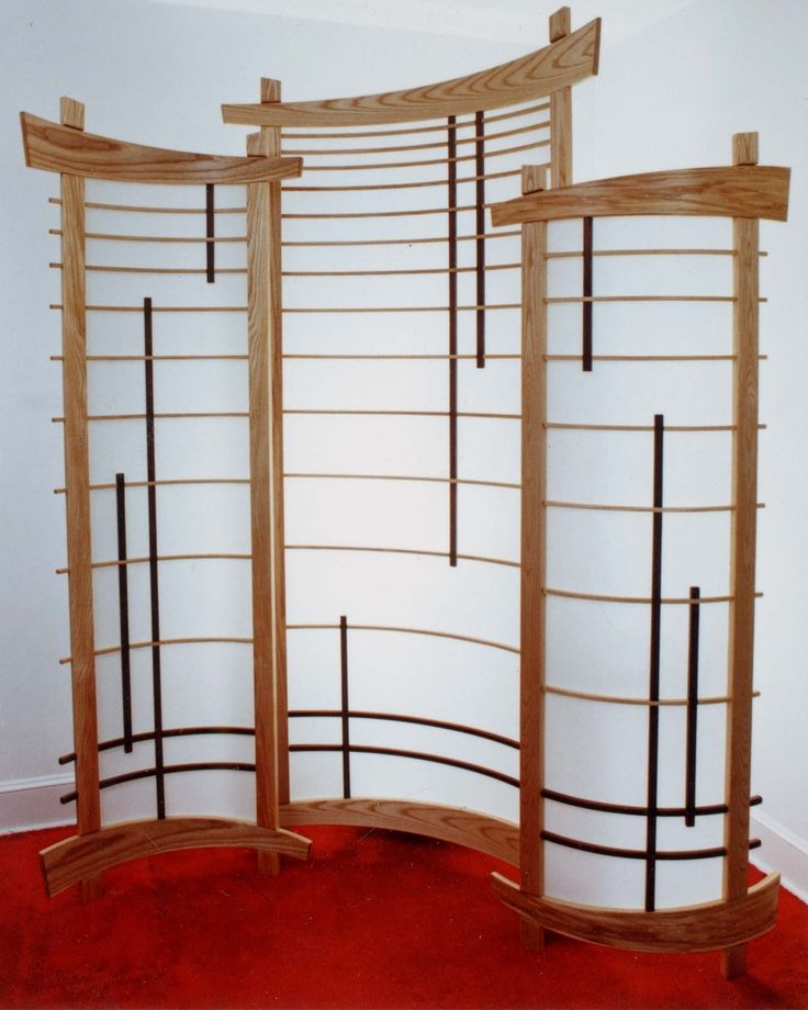Corner Shoji Screen, curved, but the curve is shallow enough that this could stand in front of vertical blinds at a remove.