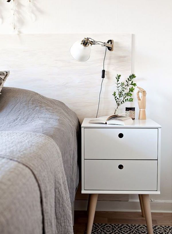 Plywood headboard in the bedroom of a fresh and light apartment in Malmö
