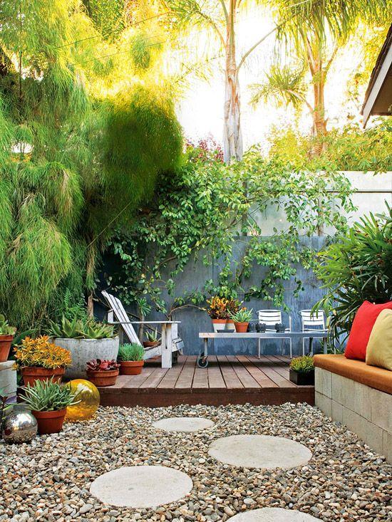 lush plantings + mixed hardscape (deck & gravel)