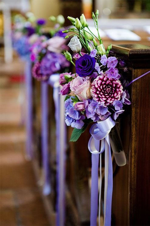 Purple Wedding Inspiration: Lavender ribbon tied around a flowers can be an elegant addition to the church pews at your ceremony. http://www.colincowieweddings.com/flowers-and-decor/purple-wedding-flowers