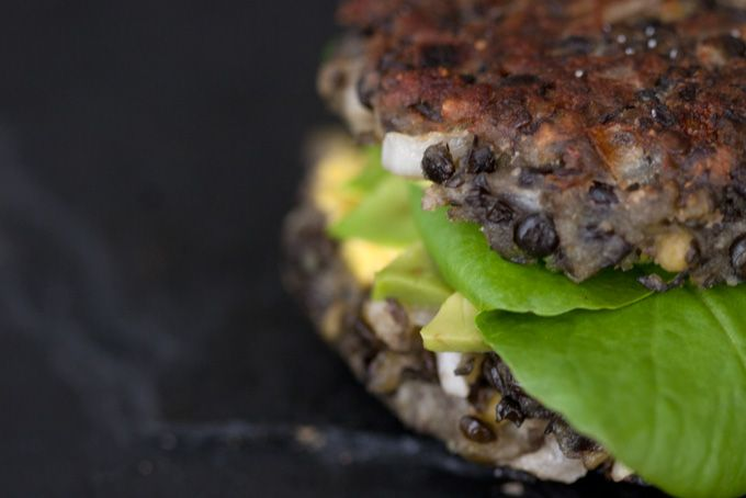 Vegetarian Lentil Burgers - Tasty, hearty vegetarian lentil burger recipe. Slathered with saffron yogurt and stuffed with avocado, lettuce, and onions.  - from 101Cookbooks.com