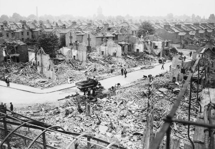 Air raid damage including wrecked houses and school in Hither Green Station area, South East London, Fall 1940.