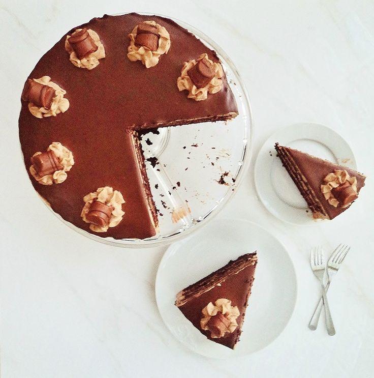 Deep velvety chocolate cake layered with creamy hazelnut praline chocolate ganache. Tastes like Bueno!