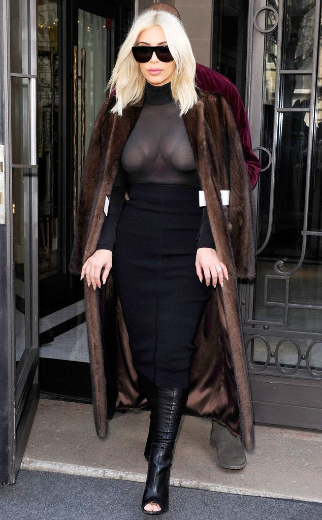 Well, hello bra! Kim leaves her Paris hotel in her favorite Givenchy boots?paired with a sheer top, midi and near floor-length fur coat.
