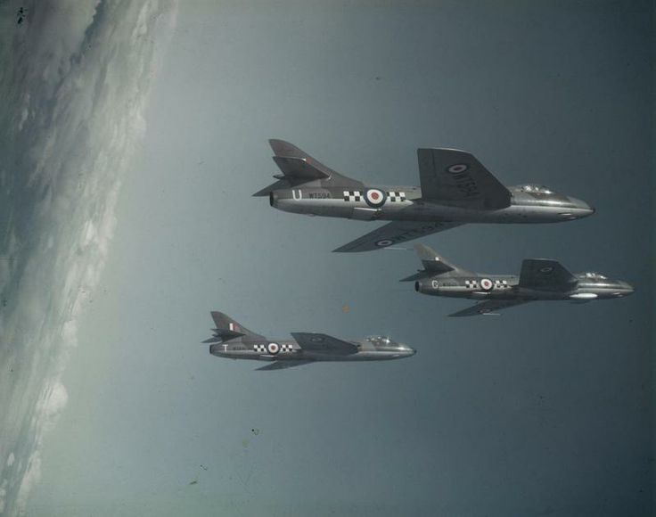 Three Hawker Hunter F.1s (WT594, WT622 and WT641) of No 43 Squadron RAF in a verticle climb, high above the clouds during a flight from their base at RAF Leuchars, Scotland.