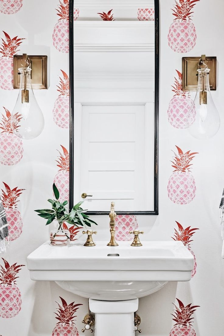 How darling! Pink pineapple wallpaper powder room bathroom gold accents eclectic bathroom coastal chic