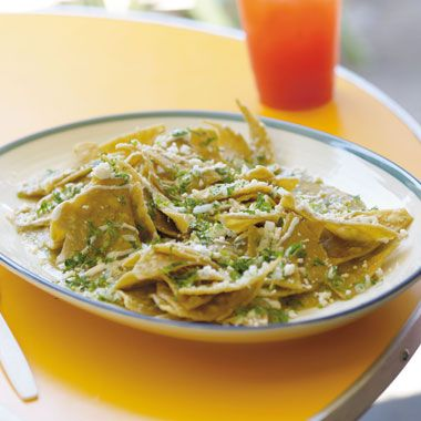 Chilaquiles Verdes _ are a traditional Mexican peasant dish of fried tortillas bathed in green or red salsa (depending on the region) until tender. Slightly tart green tomatillo sauce is preferred in Mexico City, and is very simple to make. Chilaquiles are most commonly eaten at breakfast time.