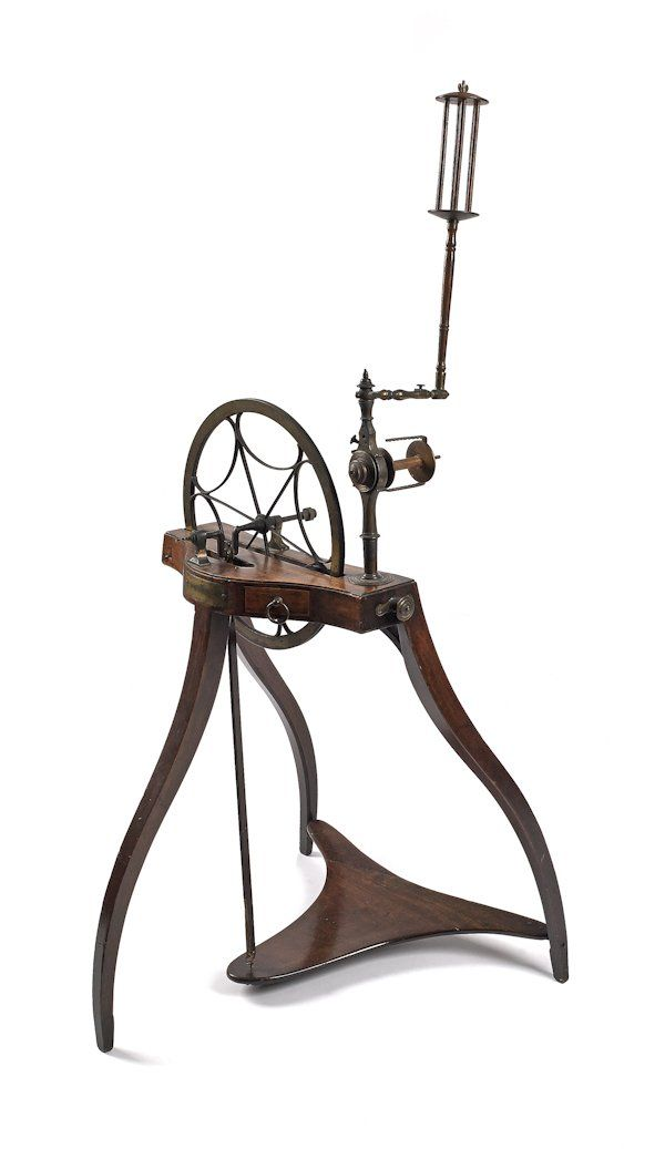Scottish mahogany and brass spinning wheel, late.  Oh my lord that's a beauty.