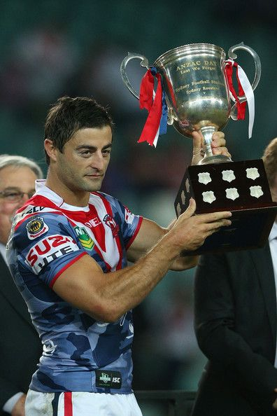 Roosters v Dragons: Roosters captain Anthony Minichiello holds the trophy aloft after winning the round seven NRL match between the Sydney Roosters and the St George Illawarra Dragons at Allianz Stadium on April 25, 2013 in Sydney, Australia.