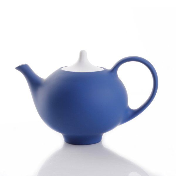 Soft and inviting matte soft touch surfaces on bold blue modern teapot with white lid. Available in three other bright colors. Stoneware with soft touch silicone surface.