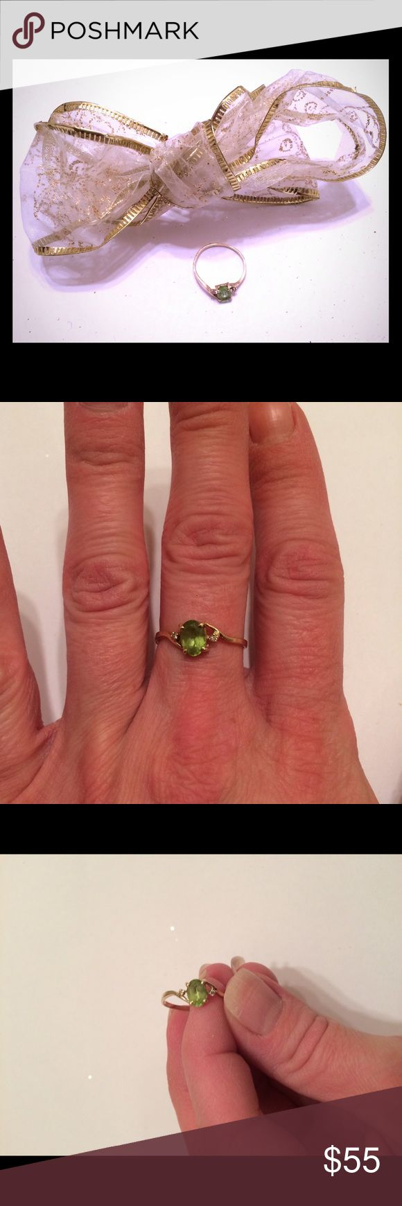 """Vintage gold peridot and diamond ring Vintage 1990's gold peridot and diamond ring size 7. Marking on inner band shows its gold, but the number has been worn off...so it may be 10k or it may be 14k. I'm not sure. If you look closely it says """"KF"""". It's a beautiful ring with a large peridot in the middle and one diamond on each side. It's a little bent from wearing it a few times but still in great condition! Vintage Jewelry Rings"""