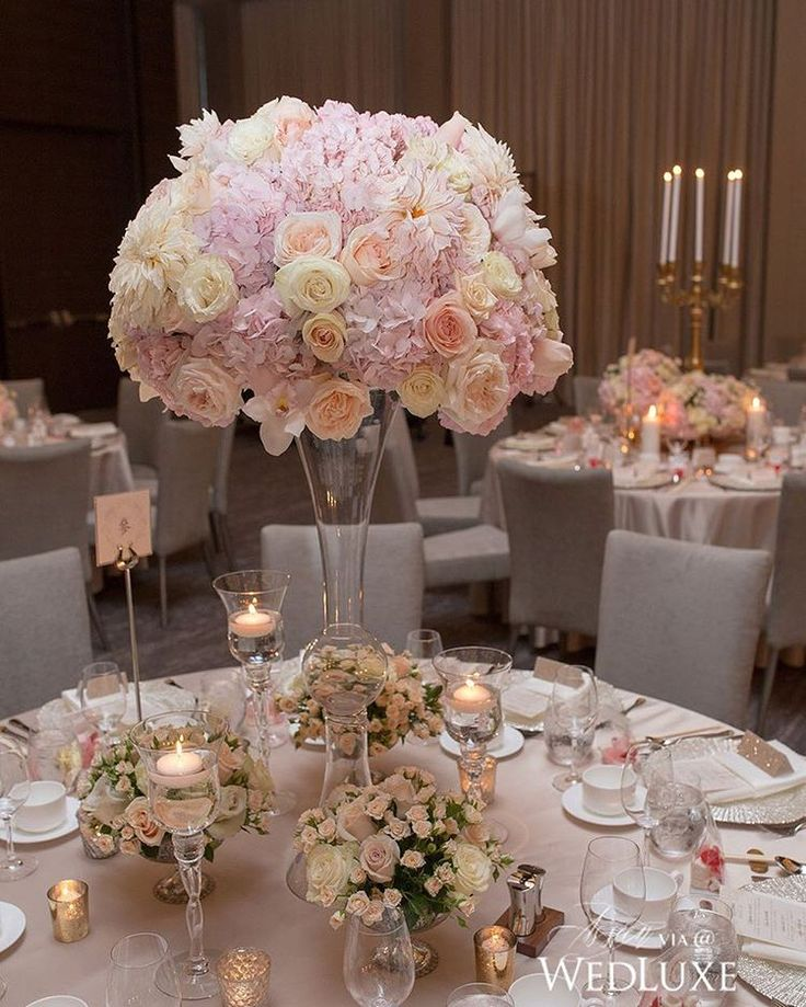 Over 5,000 blooms went into the overall design of this #wedding. We're especially fond of these fluffy #centrepieces composed of #hydrangea, #roses, and #peonies. A true floral fantasy! | Photography By: SoWedding | WedLuxe Magazine | #luxury #wedding #luxurywedding #weddinginspiration #floral #flowers #floralarrangement #tablescape #tabledecor