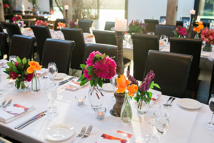 Photo of tables with an amazing wedding floral styling by The Flower Jar in Melbourne.