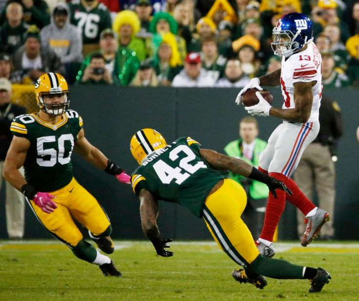 23-16, Packers:     New York Giants' Odell Beckham catches a pass in front of Green Bay Packers' Blake Martinez (50) and Morgan Burnett (42) during the first half of an NFL game Sunday, Oct. 9, 2016, in Green Bay, Wis.