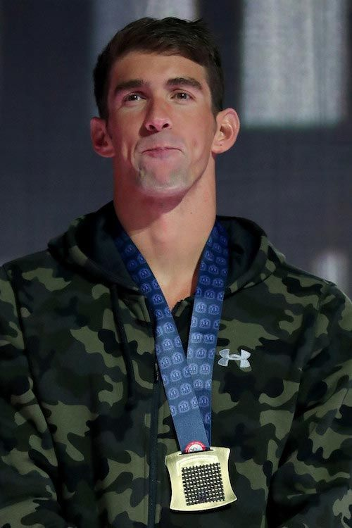 Michael Phelps during a medal ceremony for the Men's 100 Meter Butterfly competition at the 2016 USA Olympic Team Swimming Testing...