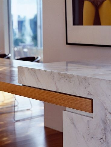 Counter ~ Adding a wood element to the stone counter - excellent joinery.
