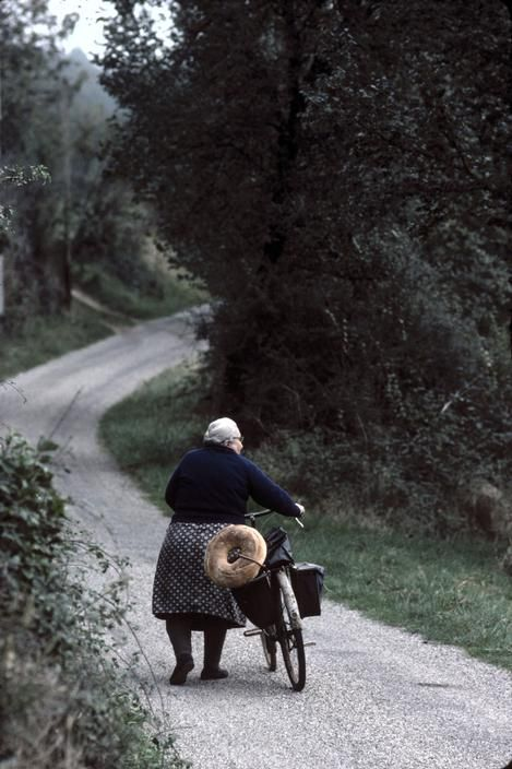 Bike, old woman & bread