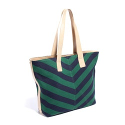 If your calendar is filling with flights to see your family for the holidays, you're going to need a great bag to help you stay organized on the go. Look no further than this striped canvas number. Its 12.5-by-17 inch body will give you more than enough space for tickets, your book and your airplane magazine of choice.