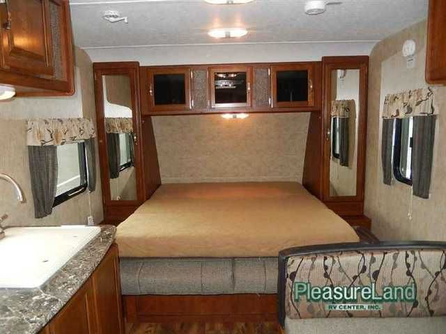 2016 New Keystone Rv Passport 195RB Express Travel Trailer in Minnesota MN.Recreational Vehicle, rv, 2016 Keystone RV Passport 195RB Express, This Passport Express travel trailer model 195RB features a rear corner bath, a Murphy bed, and all the amenities you need to take your camping up a notch!Step inside and see the rear bath straight ahead. Inside find an angled shower, toilet and sink. There is also a hardy wardrobe to your left and pantry to the right just inside the entry door.Moving…