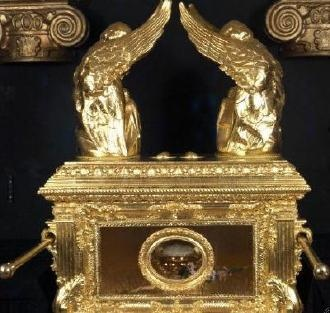 The Ark of the Covenant also known as the 'Ark of the Testimony', is a chest described in the Book of Exodus as containing the Tablets of Stone on which the Ten Commandments were inscribed and pieces of manna.  According to some traditional interpretations of the Book of Exodus, Book of Numbers, and the Letter to the Hebrews, the Ark also contained Aaron's rod, a jar of manna and the first Torah scroll as written by Moses.