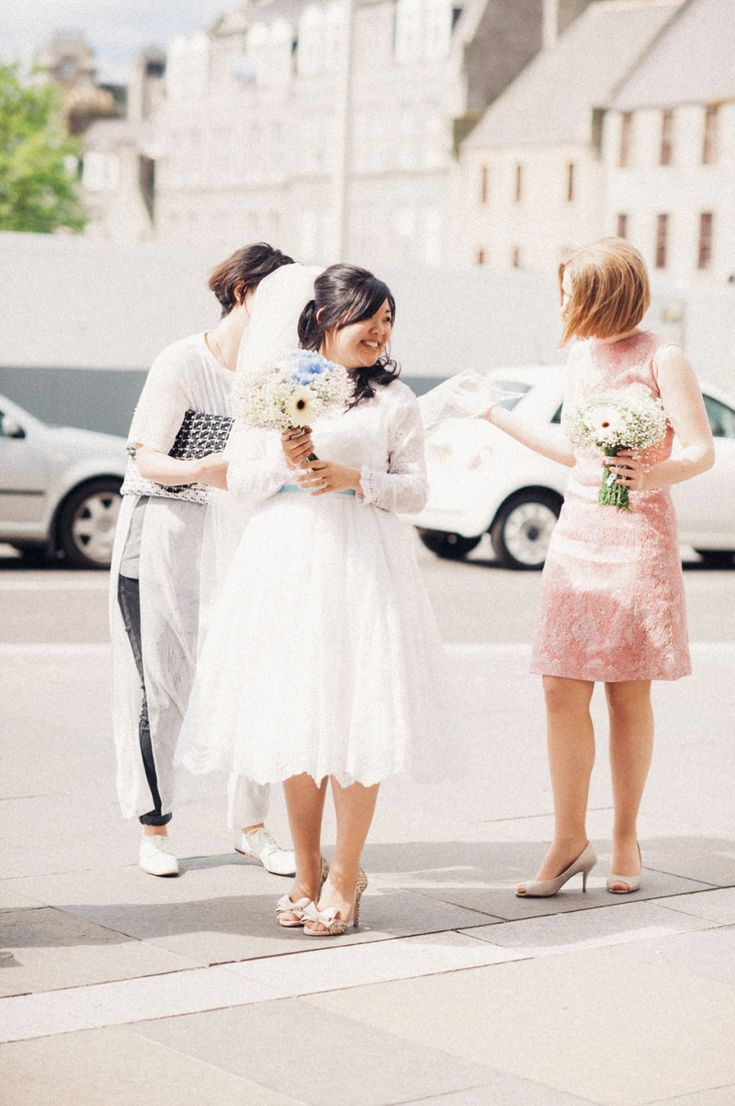 Bride wears a  1980's Short Wedding Dress | Photography by http://donnamurrayphotography.com/