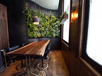 Outrageously cool plant wall, wood table and leather stools at Atera, NYC. Love the window box too.