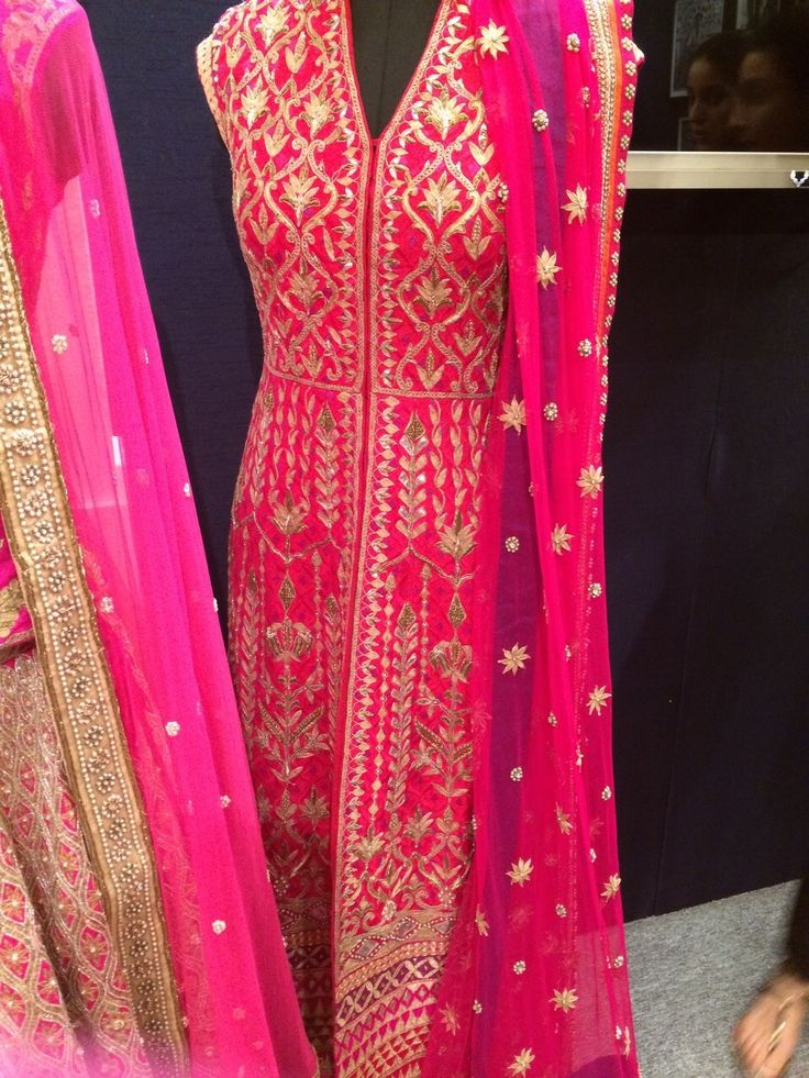 <p>Gorgeous raw silk jacket with shades of pink with raw silk royal blue cigar pants. Beautiful pink net dupatta with a royal blue border and facing.</p><p><strong>Disclaimer</strong><span> - We require 3-6 weeks for the dispatch, as the product is customized.</span></p>