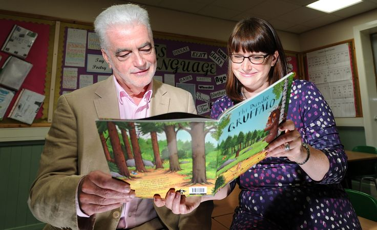 Billy Kay and Diane Anderson peruse the Dundee Gruffalo at Morgan Academy