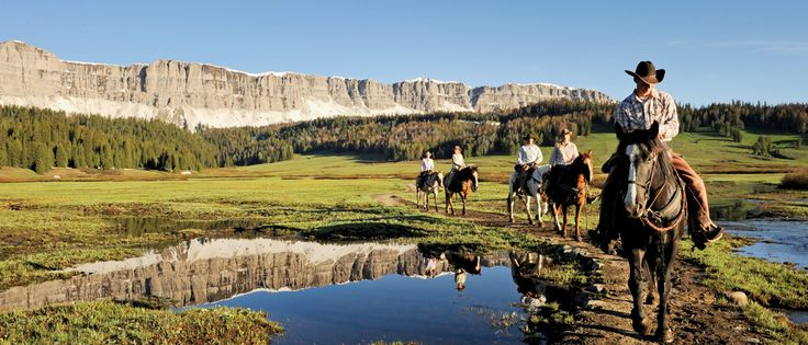 Go horseback riding through the Wyoming countryside included in our Yellowstone vacation package.