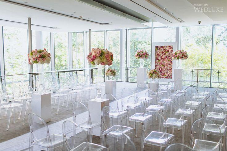Gorgeous floral ceremony backdrop!